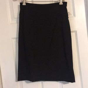 Black pencil skirt and sleeveless top